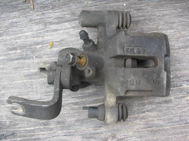 MAZDA MIATA BRAKE CALIPER AND BRACKET 90 93 LEFT REAR
