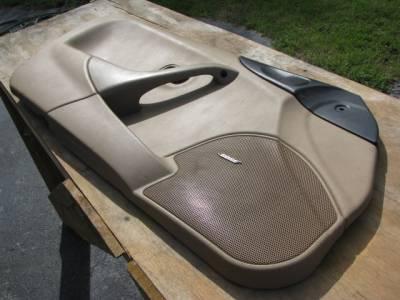 Miata '99-'00 Tan Bose Door panel, Driver - Image 1