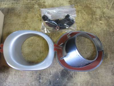 New OEM Miata '99-'00 Silver Fog Light Bezel Set with Brackets and Clips
