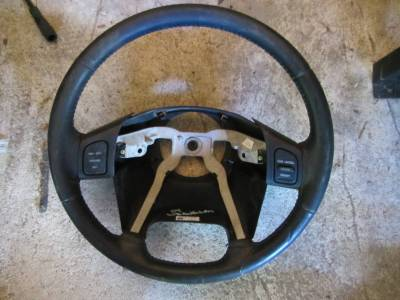 05 Jeep Wrangler tj umlimited steering wheel (with cruise control) - Image 1